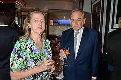 ADRIAN & The HON.MRS WHITE she is the daughter of the late Lord Howard de Walden at the Style for Soldiers dinner held at Le Caprice, 20 Arlington Street, London on 24th May 2016.