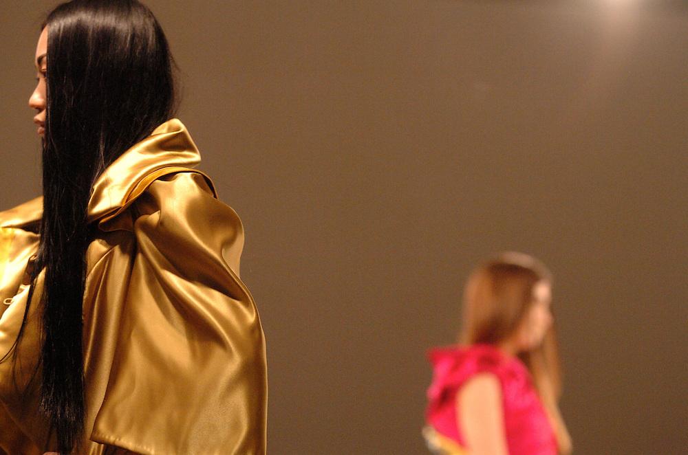 Models walk the runway at a fashion show at the Royal Academy in London.