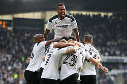 Derby County's Tom Huddlestone (top) celebrates Derby County's David Nugent's second goal of the match during the Sky Bet Championship match at Pride Park, Derby.