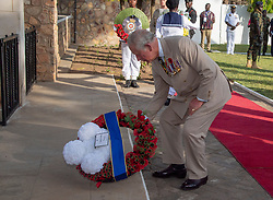 The Prince of Wales lays a wreath during a visit to the Commonwealth War Graves in Accra, Ghana, on day three of the royal couple's trip to west Africa.