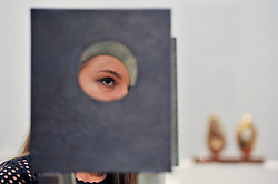 """© Licensed to London News Pictures. 15/06/2017. London, UK. A staff member is seen looking through """"Four-Square (Four Circles)"""", 1966, by Barbara Hepworth (estimate GBP200-300k).   Preview of Impressionist and Modern art sale, which will take place at Sotheby's New Bond Street on 21 June.  Photo credit : Stephen Chung/LNP"""