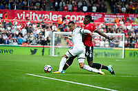 Football - 2017 / 2018 Premier League - Swansea City vs. Manchester United<br /> <br /> Martin Olsson of Swansea City is brought down by Paul Pogba of Manchester United—<br /> , at Liberty Stadium.<br /> <br /> COLORSPORT/WINSTON BYNORTH