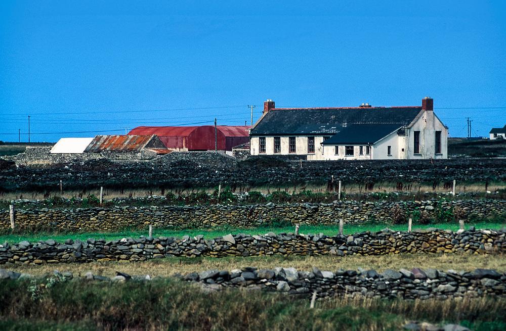 Farmhouse surrounded by quaint stone walls, Ireland