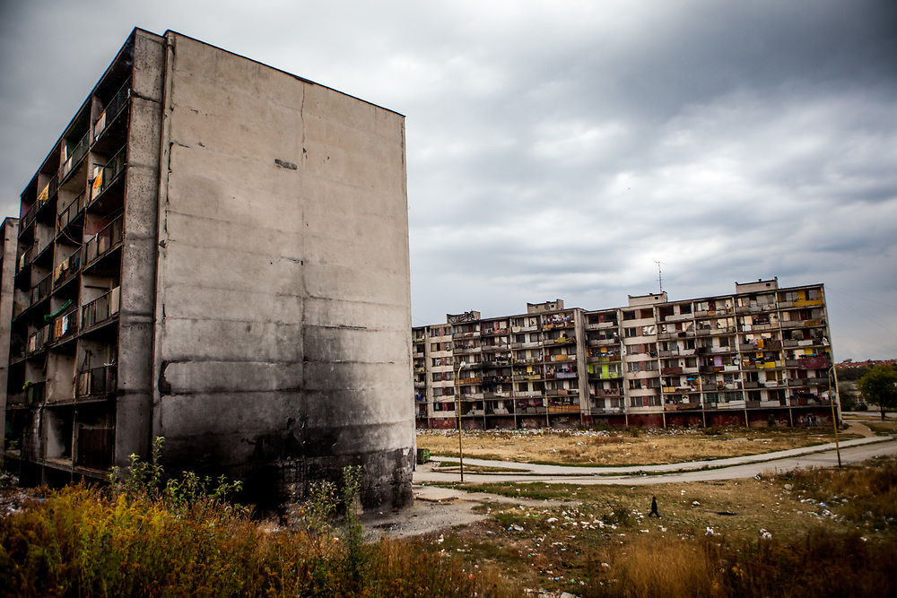 """The decrepit highrise building """"Hrebenova 34-36"""" (left) in September 2013. The building was later on demolished by the city of Kosice in August 2014. Lunik IX has officially 6542 registered (12/2015) inhabitants and almost all of them are of Roma ethnicity."""