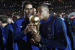 September 9, 2018 - Paris, 93, France - Kylian Mbappe, Raphael Varane of France celebrate with the World Cup Trophy after the UEFA Nations League A group official match between France and Netherlands at Stade de France on September 9, 2018 in Paris, France. This is the first match of the French football team at the Stade de France since their victory in the final of the World Cup in Russia. (Credit Image: © Mehdi Taamallah/NurPhoto/ZUMA Press)