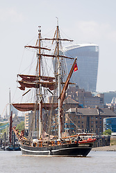 "© Licensed to London News Pictures. 23/05/2018. London, UK. The 107 year old tall ship, ""Eye of the Wind"" sails on the River Thames in front of the Leadenhall Building skyscraper during a London visit to join celebrations to mark forty years since the start of Operation Drake - a two year round the world expedition, of which Eye Of The Wind was the flagship. One of the last traditional sailing ships left, Eye of the Wind was originally built in Germany in 1911 as a Schooner but was given a new lease of life in 1973 when she was bought by Anthony ""Tiger"" Timbs, an Englishman from greater London. A group of enthusiastic ship lovers began to rig the vessel as a brigantine and her full restoration at a shipard in Faversham, Kent took nearly four years to complete. Photo credit: Vickie Flores/LNP"