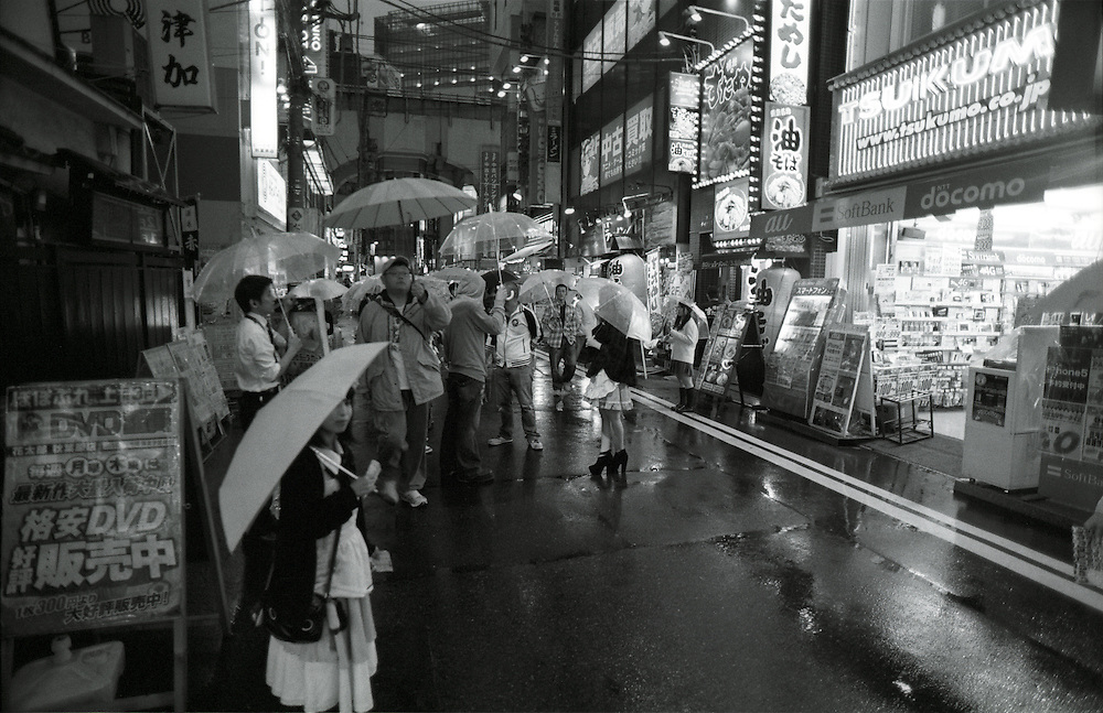 Japanese girls hand out flyers for Akihabara's maid cafe's, Tokyo, Japan.