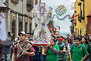 Residents carry crosses and religious icons in a procession through the Jardin Allende during the week long fiesta of the patron saint Saint Michael September 24, 2017 in San Miguel de Allende, Mexico.