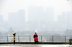 © Licensed to London News Pictures.02/03/2018<br /> Greenwich, UK.<br /> Canary Wharf view in the mist and snow.<br /> The freezing cold weather continues at Greenwich Park, Greenwich as friends, families and children enjoy time in the snow.<br /> Photo credit: Grant Falvey/LNP