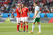 Aaron Ramsey of Wales (l) whispers and talks tactics with Gareth Bale of Wales (no11). UEFA Euro 2016, last 16 , Wales v Northern Ireland at the Parc des Princes in Paris, France on Saturday 25th June 2016, pic by  Andrew Orchard, Andrew Orchard sports photography.