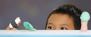 Seabury School student eyes his performers while putting on a finger puppet play.  (Photo/John Froschauer)
