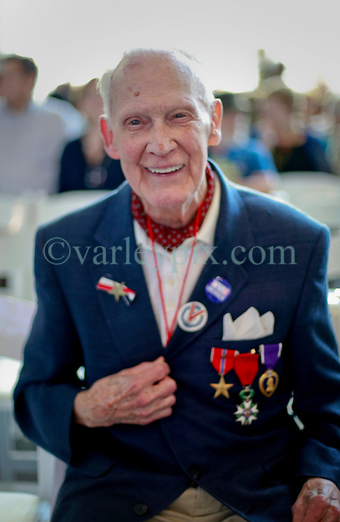 06 June 2014. The National WWII Museum, New Orleans, Lousiana. <br /> WWII veteran Staff Sgt Randy Richmond, 104th Infantry, 413th Infantry Division is honored with the French Legion of Honor medal by French Consul General, Claude Brunet..<br /> Photo; Charlie Varley/varleypix.com