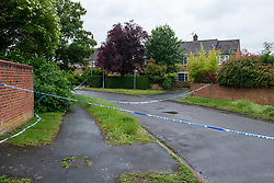 © Licensed to London News Pictures. 21/06/2021. Burnham, UK. Police tape marks a cordon following the death of a man in Wyndham Crescent in Burnham on Monday 20/06/2021. Emergency services were called at approximately 13:10BST to the Buckinghamshire street following reports of an altercation involving a group of men. Shortly after this a 35-year-old man collapsed. Thames Valley Police officers and paramedics attended the scene and performed CPR on the man but he was later pronounced dead. Photo credit: Peter Manning/LNP