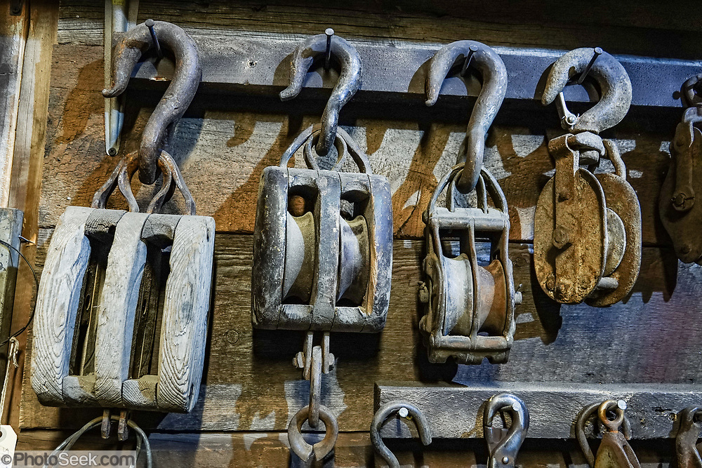 Pulleys in San Juan County Historical Society Museum, Silverton, Colorado, USA. Silverton is a former silver mining camp, now the federally-designated Silverton Historic District. Durango is linked to Silverton by the Durango and Silverton Narrow Gauge Railroad, a National Historic Landmark. Silverton no longer has active mining, but subsists on tourism, maintenance of US 550 (which links Montrose with Durango), mine pollution remediation, and retirees.