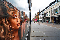 Glasgow, Scotland, UK. 1 April, 2020. Effects of Coronavirus lockdown on streets of Glasgow, Scotland. Photo of model in Victoria's Secret shop looks out on a deserted Buchanan Street.Iain Masterton/Alamy Live News