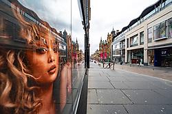 Glasgow, Scotland, UK. 1 April, 2020. Effects of Coronavirus lockdown on streets of Glasgow, Scotland. Photo of model in Victoria's Secret shop looks out on a deserted Buchanan Street.Iain Masterton/Alamy Live News