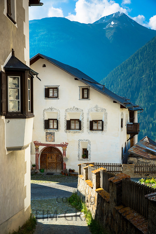 In the Engadine Valley the village of Guarda - old painted stone 17th Century buildings, Switzerland