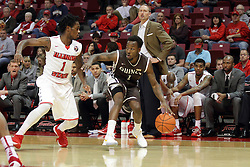 27 November 2015: Thomas Jackson works the outside against Paris Lee(1). Illinois State Redbirds host the Quincy Hawks at Redbird Arena in Normal Illinois (Photo by Alan Look)