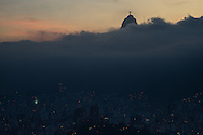 The Cristo Redemtor status rises above low cloud, with the lights of Rio de Janeiro below. Scenes from Rio de Janeiro on the day that Brazil drew 0-0 with Mexico. Photo by Andrew Tobin/Tobinators Ltd