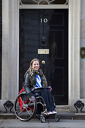 © licensed to London News Pictures. London, UK 27/02/2013. GB double gold medalist Hannah Cockroft in Downing Street to promote 'Get Inspired' manifesto for a Paralympic legacy and improvement of opportunities for disabled people. Photo credit: Tolga Akmen/LNP