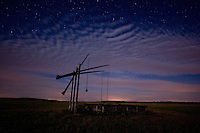 Typical Hortobagy water well on a cloudy night in moonlight, Hortobagy National Park, Hungary