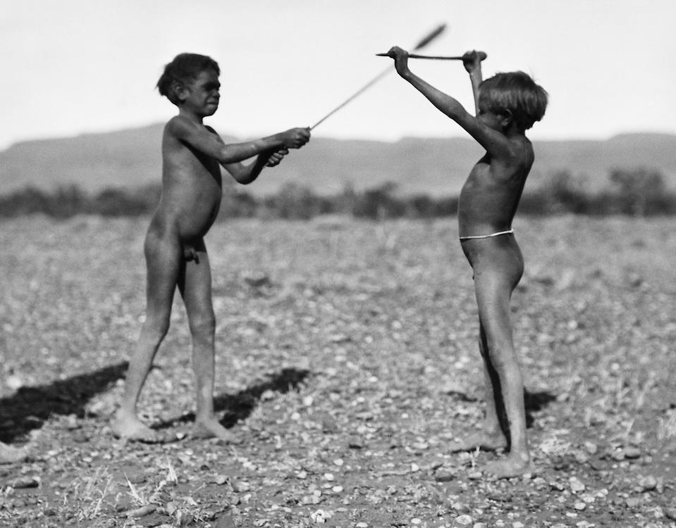 Aborigine boys fencing, Central Australia, 1930
