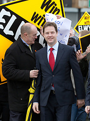 © under license to London News Pictures. 05/01/2011. Party activists scuffle with student protester, Jessica Leah, twenty, of Stalybridge, who tries to wave a sign in protest of tuition fees as Nick Clegg joins party activists a branch of Asda in Oldham. Clegg was campaigning for the Oldham East and Saddleworth By-Election. Photo Credit Should read: Joel Goodman/London News Picture