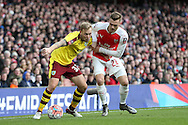 Scott Arfield of Burnley is intercepted by Calum Chambers of Arsenal. The Emirates FA cup, 4th round match, Arsenal v Burnley at the Emirates Stadium in London on Saturday 30th January 2016.<br /> pic by John Patrick Fletcher, Andrew Orchard sports photography.