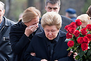 Moscow, Russia, 26/04/2007..Boris Yeltsin's widow Naina and daughters Yelena [black scarf] and Tatyana [dark glasses] make a private visit to to his grave the morning after the former Russian President was buried. Yelena weeps as her mother says a prayer over Boris Yeltsin's grave..