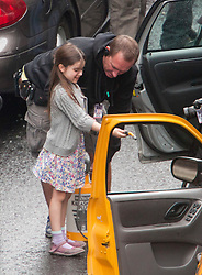 """Day two of filming. The youngest of Brad Pitt's co-star helps to wet their car on the set of the movie """"World War Z"""" being shot in the city centre of Glasgow. The film, which is set in Philadelphia, is being shot in various parts of Glasgow, transforming it to shoot the post apocalyptic zombie film.."""