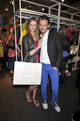 MATTHEW WILLIAMSON and ROSIE HUNTINGTON WHITELEY at a party to celebrate the launch of the Matthew Williamson collection at H&M held at the H&M store, Regent Street, London on 22nd April 2009.
