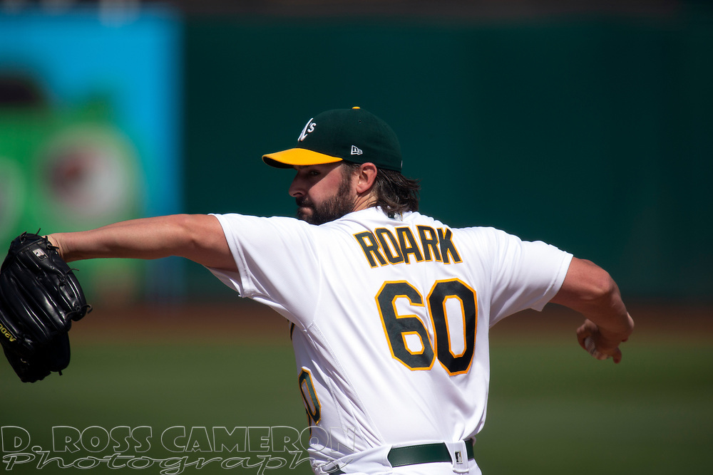 Oakland Athletics starting pitcher Tanner Roark (60) delivers against the Texas Rangers during the third inning of a baseball game, Sunday, Sept. 22, 2019, in Oakland, Calif. (AP Photo/D. Ross Cameron)