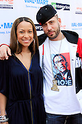 """Valiesha Butterfield, President, HipHop Action Network and DJ Drama at the Hip-Hop Summit's """"Get Your Money Right"""" Financial Empowerment International Tour draws hip-hop stars and financial experts to teach young people about financial literacy held at The Johnson C. Smith University's Brayboy Gymnasium on April 26, 2008..For the past three years, hip-hop stars have come out around the country to give back to their communities. Sharing personal stories about the mistakes they've made with their own finances along the way, and emphasizing the difference between the bling fantasy of videos and the realities of life, has helped young people learn the importance of financial responsibility while they're still young. With the recent housing market crash in the United States affecting the economy, jobs, student loans and consumer confidence, young people are eager to receive sound financial advice on how to best manage their money and navigate through this volatile economic environment.."""
