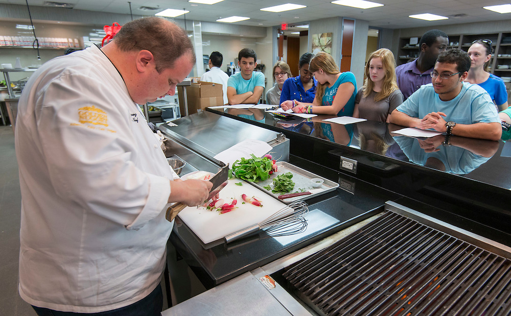 Students from Carnegie Vanguard High School learn about Farm to Table food and cooking from Landry's executive chef Carlos Rodriguez at the Landry's test kitchen, March 1, 2014.