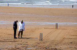 Embargoed to 0001 Monday August 28 The crease is prepared before match between the Ship Inn Cricket Club and the Eccentric Flamingoes Cricket Club on Sunday April 30th, 2017, in front of the pub in Elie, Fife, which is the only one in Britain to have a cricket team with a pitch on the beach. The Ship Inn Cricket Club season runs from May to September with dates of matches dependent on the tides. Any Batsman who hits a six which lands in the Ship Inn beer garden wins their height in beer and any spectator who catches a six in the beer garden also wins their height in beer.