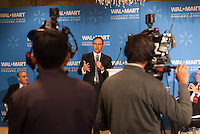 H.Lee Scott Jr, Walmart chief executive answers questions during a conference in Beijing.