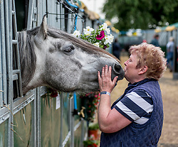 6 year old Highland pony Skye from Acrington, Lancashire nuzzles up to visiting groom Andrea Wilson from Ayr during final preparations for this years Royal Highland Show at Ingliston near Edinburgh.<br /> <br /> © Dave Johnston/ EEm