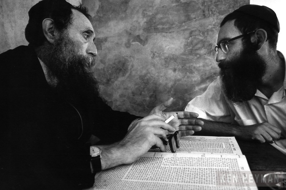 A scholar in Israel is teaching the Talmud.