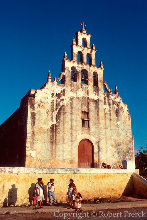MEXICO, YUCATAN PENINSULA Tahmek, town with small colonial church with simple but elegant facade and belltower traditional to this area