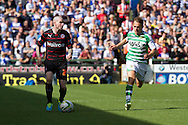 James Hayter of Yeovil Town (r) and Danny Guthrie of Reading during the Skybet championship match, Yeovil Town v Reading at Huish Park in Yeovil on Saturday 31st August 2013. <br /> Picture by Sophie Elbourn, Andrew Orchard sports photography,