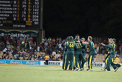 © Licensed to London News Pictures. 08/03/2012. Adelaide Oval, Australia. The Australian team come together in celebration after winning the final during the One Day International cricket match final between Australia Vs Sri Lanka. Photo credit : Asanka Brendon Ratnayake/LNP