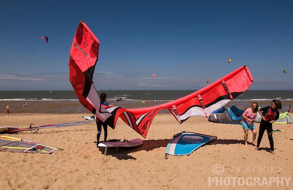 A kitesurfer readies their equipment for action. (Photo © Jock Fistick)