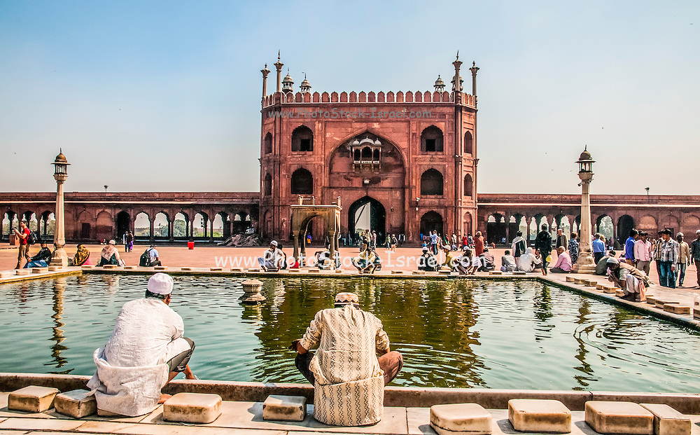 Jama Masjid, India's largest mosque, Delhi, India Muslim men wash in water pool before entering the mosque