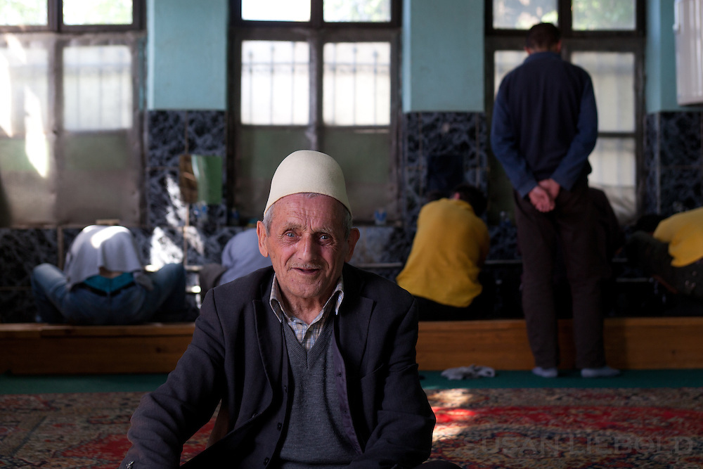 Man in a Pristina mosque is preparing to prayer before entering the prayer room.