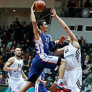 Anadolu Efes's Matthew Janning (C) during their Turkish basketball league match Besiktas integral Forex between Anadolu Efes at BJK Akatlar Arena in Istanbul, Turkey, Monday, January 05, 2015. Photo by TURKPIX