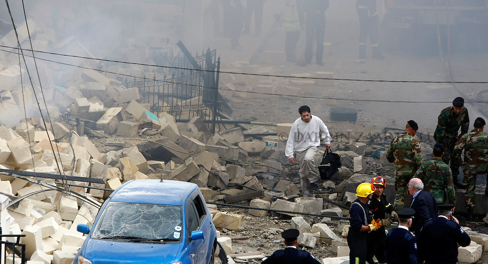 A man walks through the debris on the site of an illegal fireworks factory which exploded in the heart of a residential area, demolishing three houses in Naxxar, outside Valletta, March 12, 2008.  Local media reported that two people were killed and three injured...REUTERS/Darrin Zammit Lupi (MALTA)..MALTA OUT