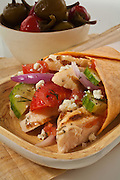 Chicken salad,greek style,wrap showing cherry peppers,both verticle and horizontal