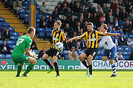 Southend's goalkeeper Daniel Bentley and defenders Ben Coker (goalscorer) and Mark Phillips block off the challenge of Bury's Craig Jones. Skybet football league two match, Bury v Southend Utd at Gigg Lane in Bury, England on Sat 21st Sept 2013. pic by David Richards/Andrew Orchard sports photography