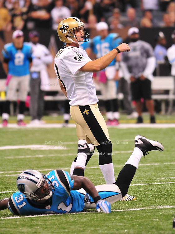 """New Orleans Saints kicker John Carney, recently resigned, is seen kicking one of his 3 field goals for the Saints during their game against the Carolina Panthers Sunday Oct. 3,2010. The NFL has gone """"Pink"""" for October in honor of Breast Cancer Awareness. The Saints went on to win 16-14. John Carney kicked three field goals to help the Saints win. PHOTO©SuziAltman.com"""