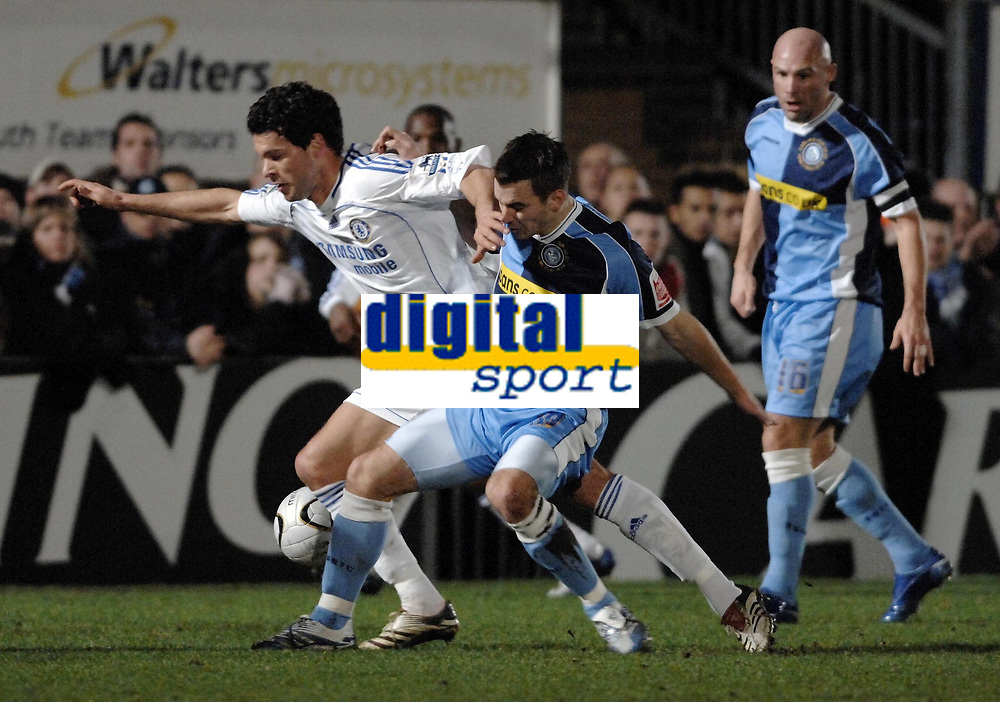 Photo: Richard Lane.<br />Wycombe Wanderers v Chelsea. Carling Cup, Semi Final 1st Leg. 10/01/2007. <br />Chelsea's Michael Ballack is challenged by Wycombe's Matt Bloomfield.